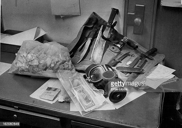 JAN 18 1977 JAN 19 1977 Knives Gas Masks Among Items Seized Police also confiscated suspected amphetamines and marijuana