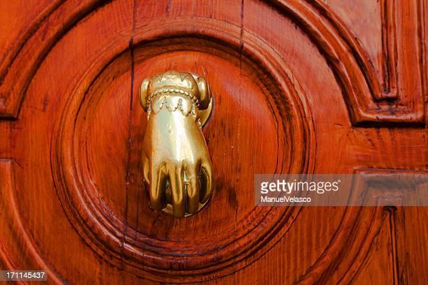 knocker hand - door knocker stock photos and pictures