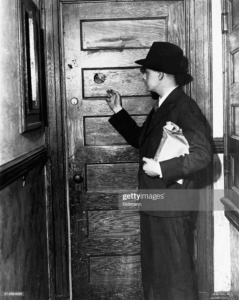 Knocking at door of a speakeasy during Prohibition. A man with a package approaches a & Door to Speakeasy Pictures | Getty Images
