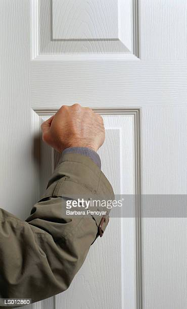 knocking on door - knocking on door stock photos and pictures