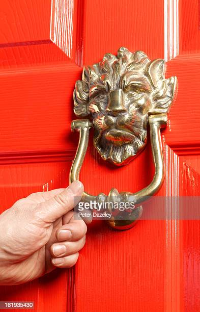 knocking on red door - knocking on door stock photos and pictures