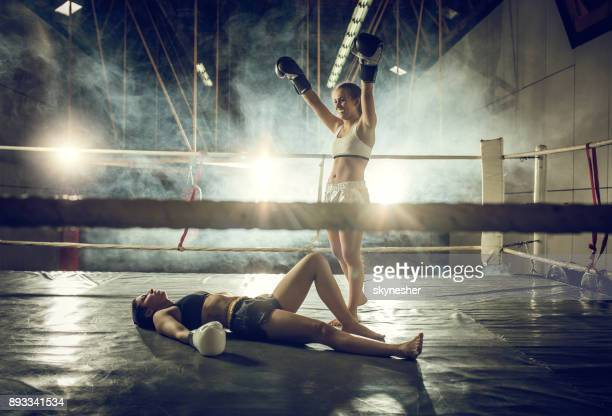 knockout on a boxing match! - muay thai stock pictures, royalty-free photos & images