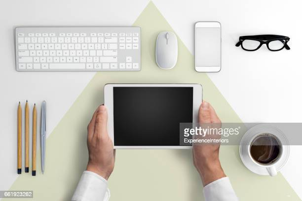 Knolling business hipster man holding tablet