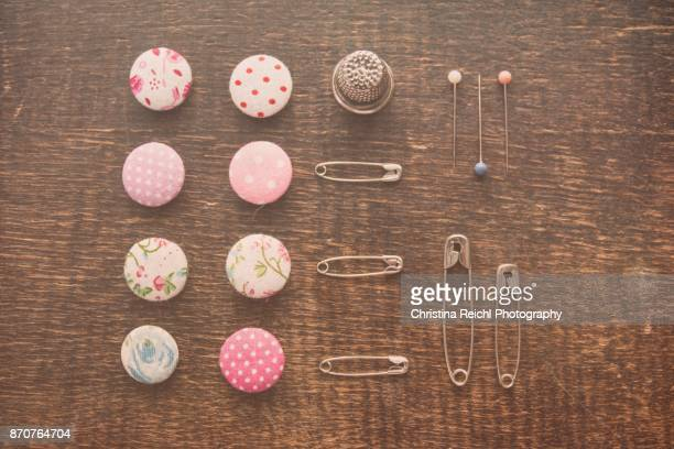 Knolling buttons, safety pin and pins