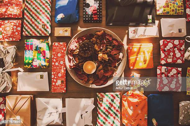 Knolling Christmas gifts at home in a wood table with Christmas decoration taken from above in nice composition.