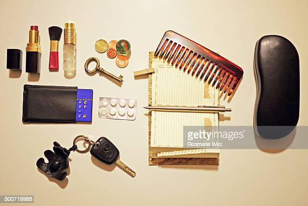 knolling: lady's personal objects overhead view - belongings stock photos and pictures