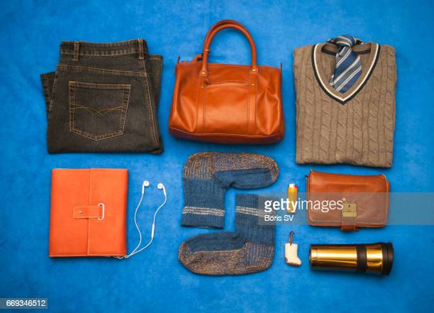 Knolling man's wardrobe and personal items with vivid colors.