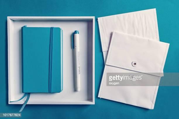 Knolling Office sets on a blank aqua paper