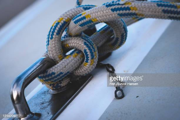 knot on a rope on a sailingboat - finn bjurvoll stock pictures, royalty-free photos & images