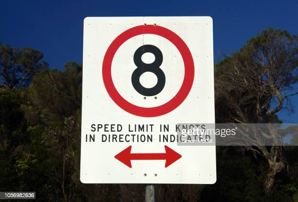 '8 knots: speed limit in knots in direction indicated' sign - double arrow stock pictures, royalty-free photos & images