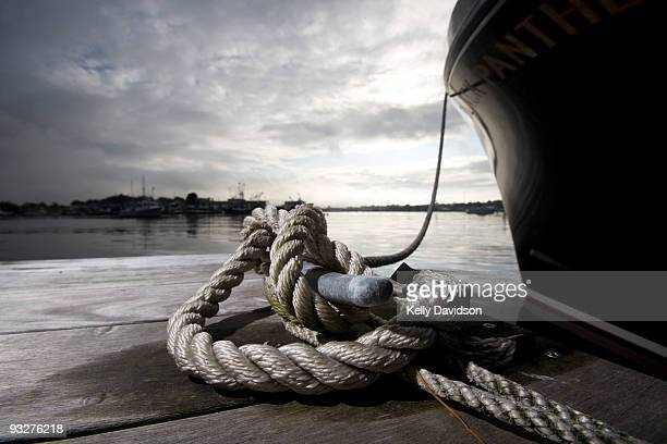 knotted rope  - bollard stock photos and pictures