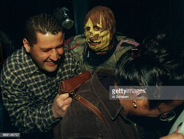 PARK––Knott's Scary Farm monster sneaks up on victims in the Nightmare maze Saturday evening amidst a sold–out night at Knott's Berry Farm's annual...