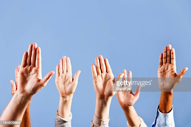 I know the answer! Six raised hands against blue