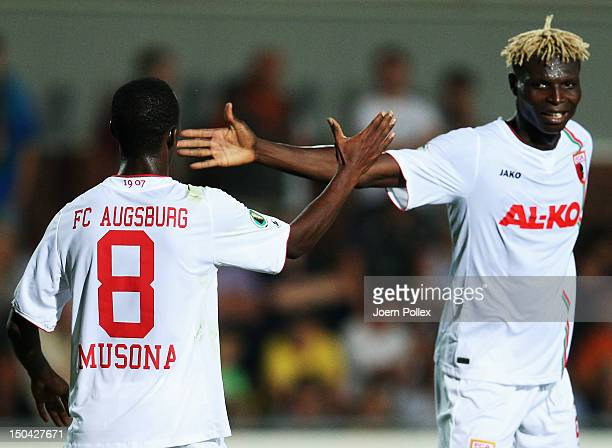 Knowledge Musona of Augsburg celebrates with his team mate Aristide Bance after scoring his team's second goal during the DFB Cup first round match...