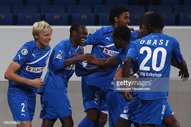 Knowledge Musona of Hoffenheim celebrates scoring the second team goal with his team mates during the DFB Pokal second round match between TSV 1899...