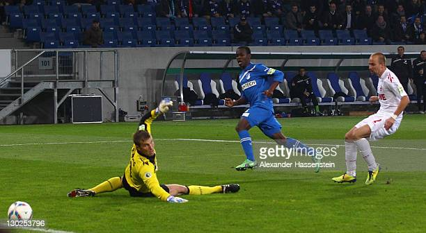 Knowledge Musona of Hoffenheim scores the second team goal against Michael Rensing, keeper of Koeln and his team mate Miso Brecko during the DFB...