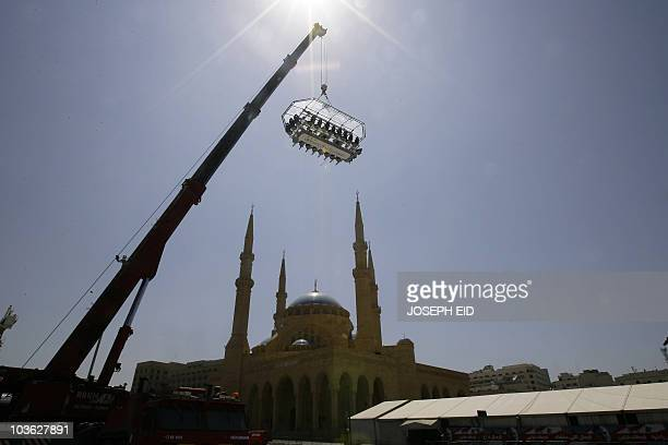 Known as the �Dinner in the Sky' venue a dining table which seats 22 people and accommodates the servers is lifted 50 meters into the air by a crane...