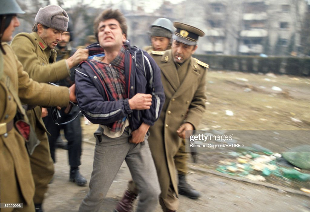 A known collaborater with the Ceausescu regime is picked up by soldiers in Timisoara during the Romanian Revolution, December 1989.
