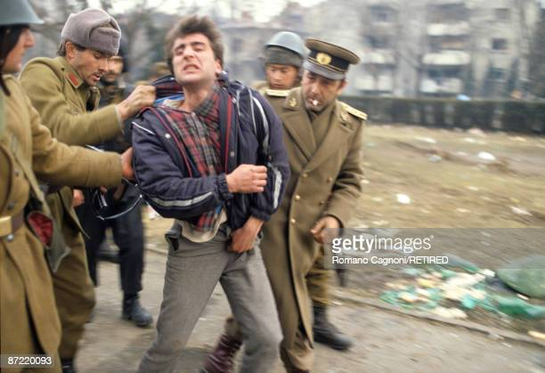 A known collaborater with the Ceausescu regime is picked up by soldiers in Timisoara during the Romanian Revolution December 1989