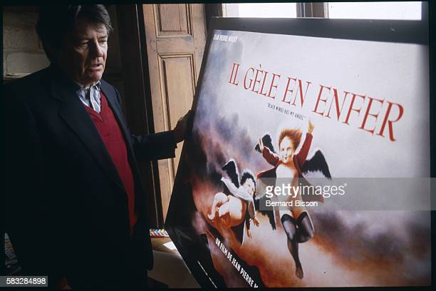 Known for his black humor and cynicism French director JeanPierre Mocky poses with his controversial film poster Il Gele en Enfer which was banned...