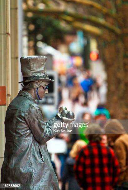 CONTENT] Known to most as Mr Statue Wells Oviatt stands next to Pioneer Place in the middle of downtown Portland Oregon on a busy Sunday afternoon...