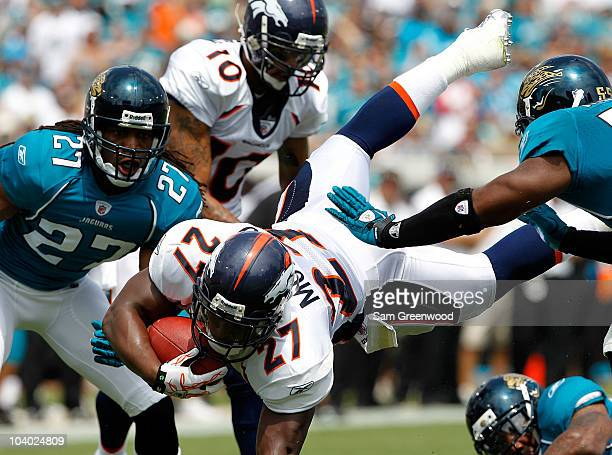 Knowshon Moreno of the Denver Broncos dives for a firstdown during the NFL season opener game against the Jacksonville Jaguars at EverBank Field on...