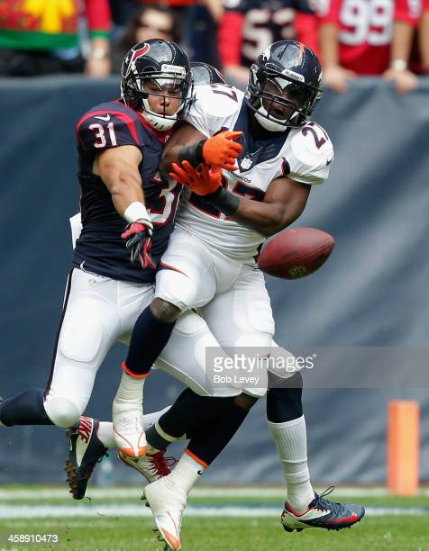Knowshon Moreno of the Denver Broncos has the ball knocked away by Shiloh Keo of the Houston Texans at Reliant Stadium on December 22, 2013 in...