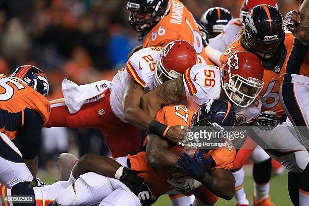 Knowshon Moreno of the Denver Broncos is tackled by Derrick Johnson of the Kansas City Chiefs in the first half at Sports Authority Field at Mile...