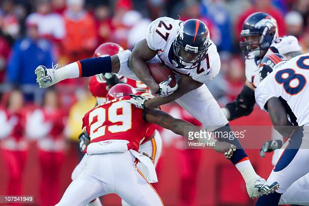 Knowshon Moreno of the Denver Broncos jumps over Eric Berry of the Kansas City Chiefs on December 5 2010 at Arrowhead Stadium in Kansas City Missouri...