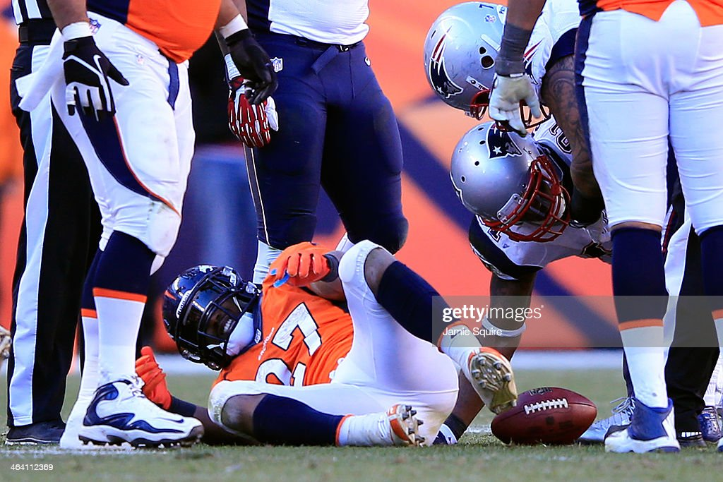 Knowshon Moreno #27 of the Denver Broncos lays on the ground after a run against the New England Patriots during the AFC Championship game at Sports Authority Field at Mile High on January 19, 2014 in Denver, Colorado.
