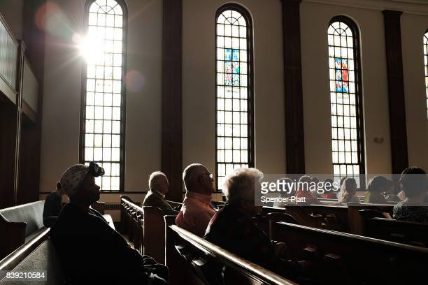 Knoxville residents participate in a service of prayers and hymns for peace in advance of a planned white supremacist rally and counterprotest around...