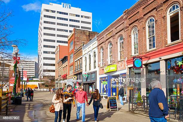 knoxville tennessee downtown people walk at market square - knoxville tennessee stock pictures, royalty-free photos & images