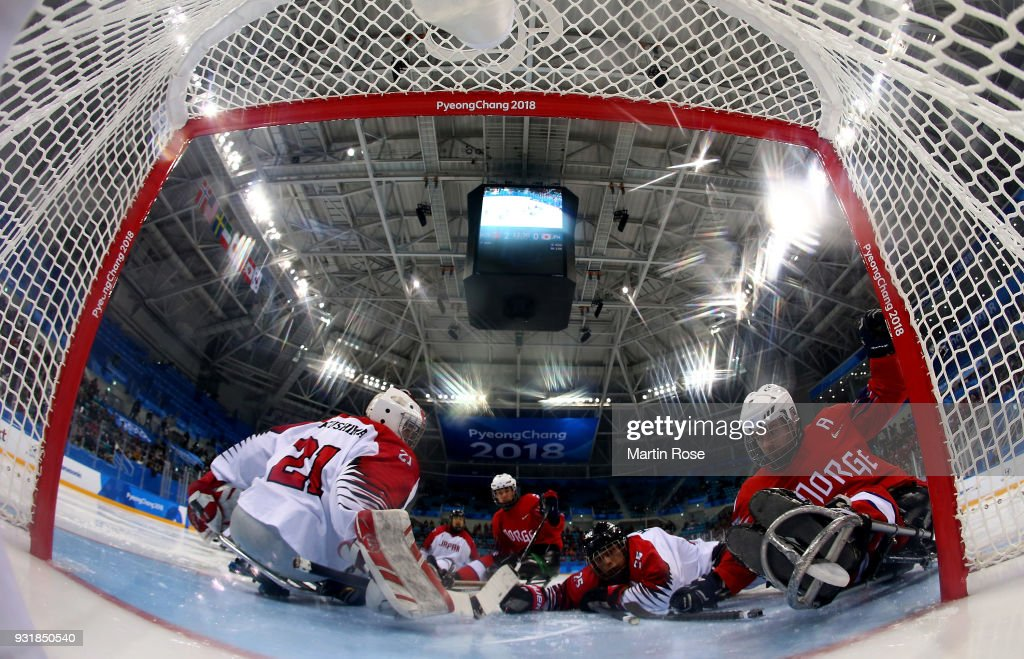 Knut Andre Nordstoga (R) of Norway scores a goal over Shinobu Fukushima, goaltender of Japan in the Ice Hockey Classification game between Norway and Japan during day five of the PyeongChang 2018 Paralympic Games on March 14, 2018 in Gangneung, South Korea.