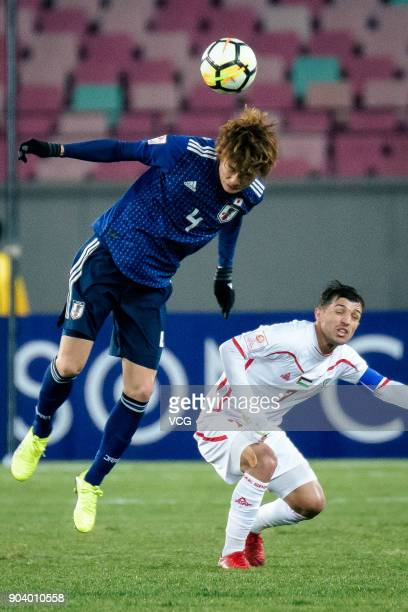 Ko Itakura of Japan and Mahmoud Abu Warda of Palestine compete for the ball during the AFC U23 Championship Group B match between Japan and Palestine...