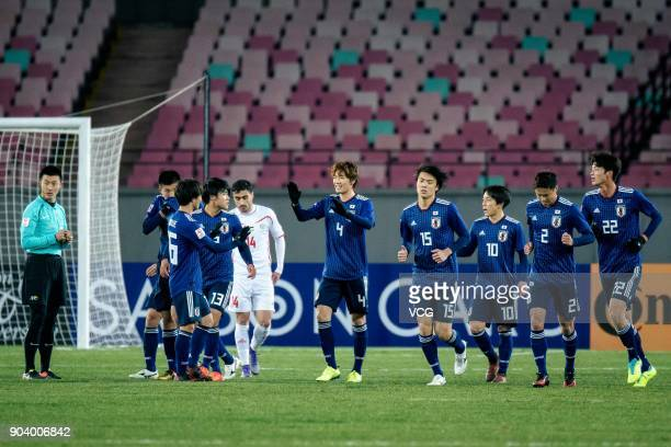 Ko Itakura of Japan celebrates with team mates after scoring his team's first goal during the AFC U23 Championship Group B match between Japan and...