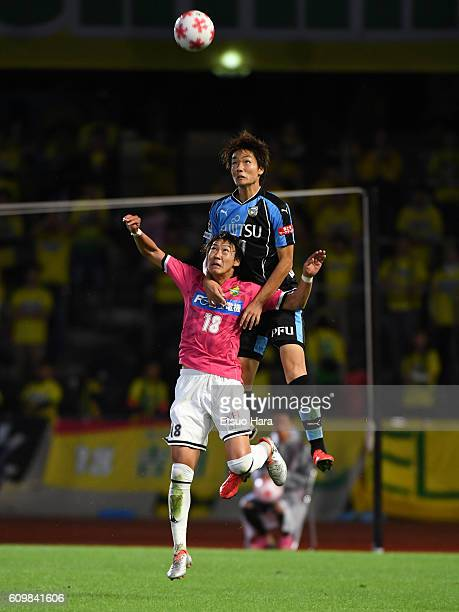Ko Itakura of Kawasaki Frontale and Makito Yoshida of JEF United Chiba#18 compete for the ball during the Emperor's Cup third round match between...