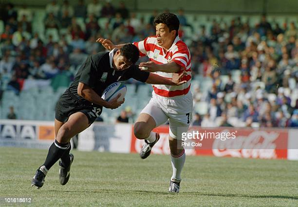 Ko Izawa tackles Alama Ieremia during the pool stage game between Japan and New Zealand at the 1995 Rugby World Cup the Free State Stadium...