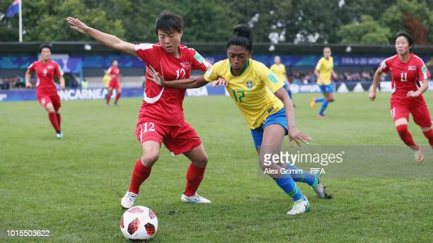 Ko Kyong Hui of Korea DPR is challenged by Kerolin of Brazil during the FIFA U20 Women's World Cup France 2018 group B match between Brazil and Korea...
