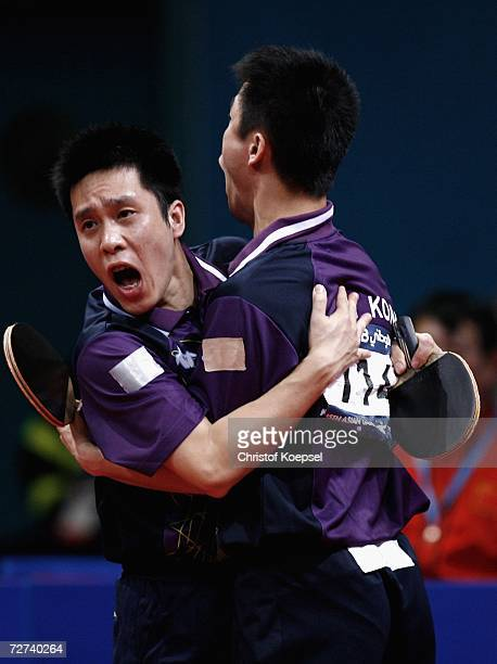 Ko Lai Chak and Li Ching of Hong Kong celebrate the 4:2 victory by sets against Ma Long and Wang Hao of China during the men's doubles semifinal at...
