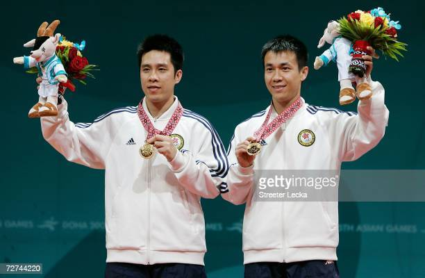 Ko Lai Chak and Li Ching of Hong Kong, China wave to the crowd after winning the Gold Medal in the Men's Doubles Table Tennis Competition during the...