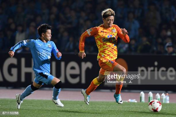 Ko Matsubara of Shimizu S-Pulse and Tatsuya Hasegawa of Kawasaki Frontale compete for the ball during the J.League J1 match between Kawasaki Frontale...