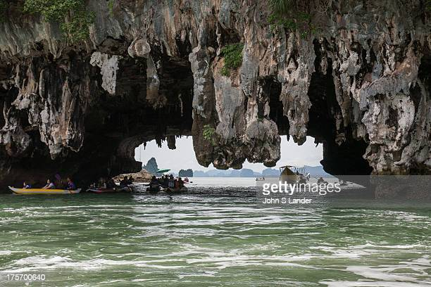 Ko Phanak and Ko Hong in Phang Nga Bay are known for their collapsed cave systems full of stalactites that are popular for sea kayaing and canoe...