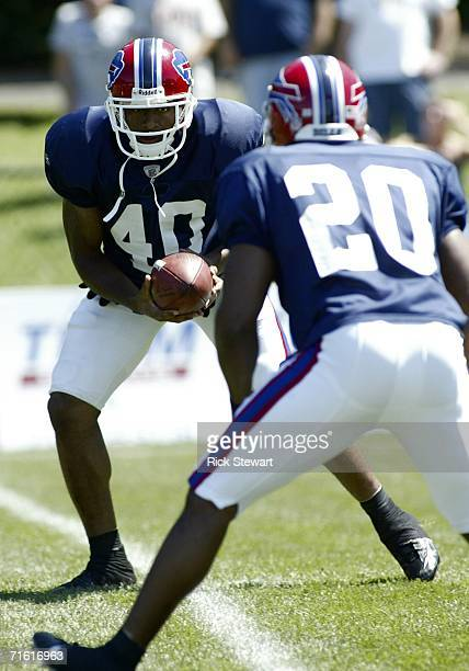 Ko Simpson and Donte Whitner of the the Buffalo Bills run drills during training camp on August 9 2006 at St John Fisher College in Pittsford New York