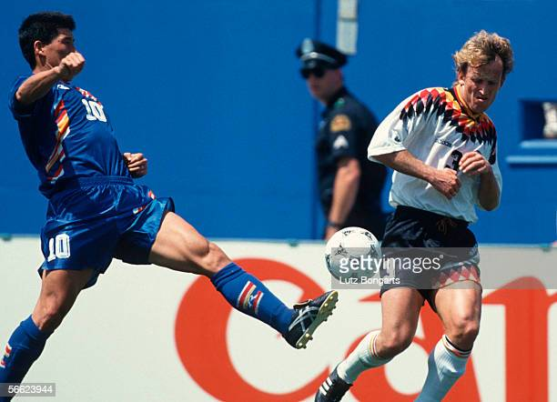 Ko Yeong Woon of South Korea and Andreas Brehme of Germany in action during the World Cup match between Germany and South Korea on June 27, 1994 in...