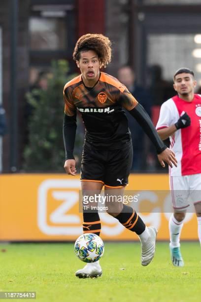 Koba Koindredi of FC Valencia U19 controls the ball during the UEFA Youth League match between Ajax Amsterdam U19 and FC Valencia U19 on December 10...