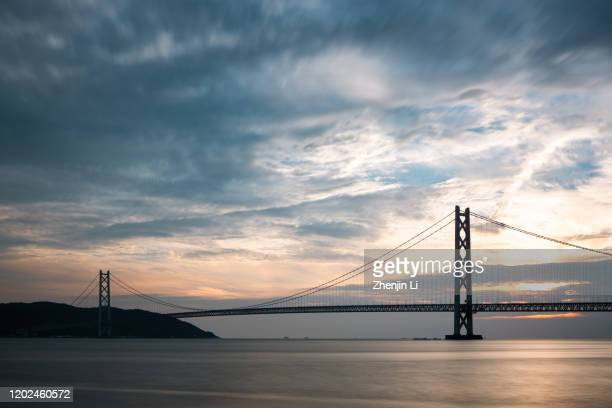 kobe akashi-kaikyo bridge over sea distant view / kobe, japan - 兵庫県 ストックフォトと画像