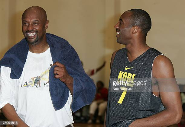 Kobe and Joe Bryant share a laugh at the Kobe Basketball Academy at Loyola Marymount University on July 5 2007 in Los Angeles California