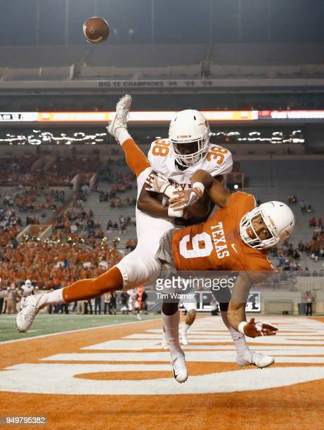 Kobe Boyce of the Texas Longhorns breaks up a pass intended for Collin Johnson in the endzone during the third quarter of the OrangeWhite Spring Game...