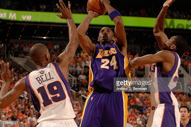Kobe Bryan of the Los Angeles Lakers shoots through the double team of Raja Bell and James Jones of the Phoenix Suns in Game One of the Western...