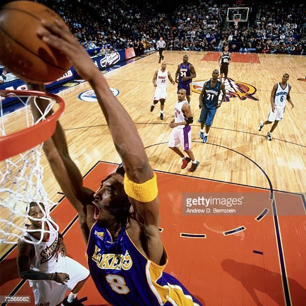 Kobe Bryan of the Western Conference AllStars attempts a dunk against the Eastern Conference AllStars during the 2000 NBA AllStar Game at The Arena...